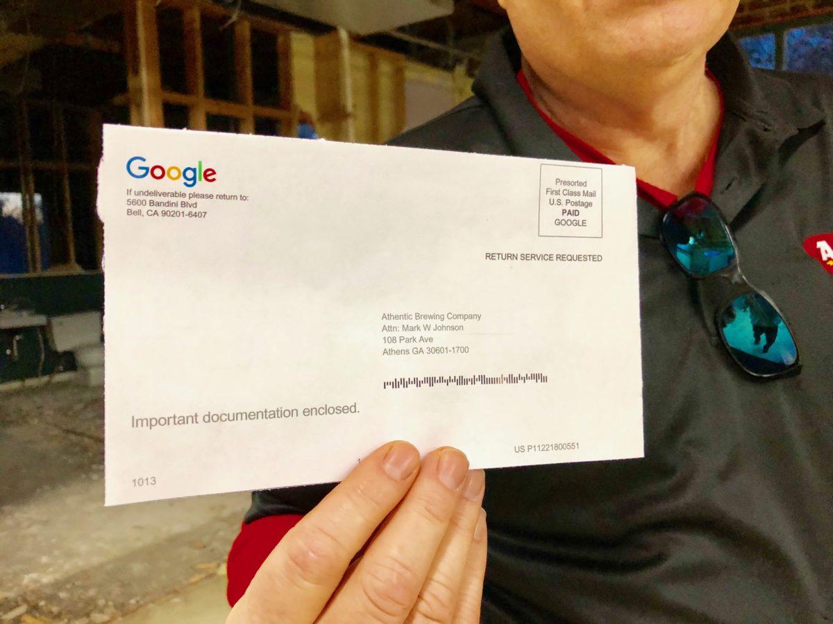 Mark holding google postcard