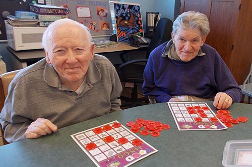 Senior members of our population enjoying a game of bingo.