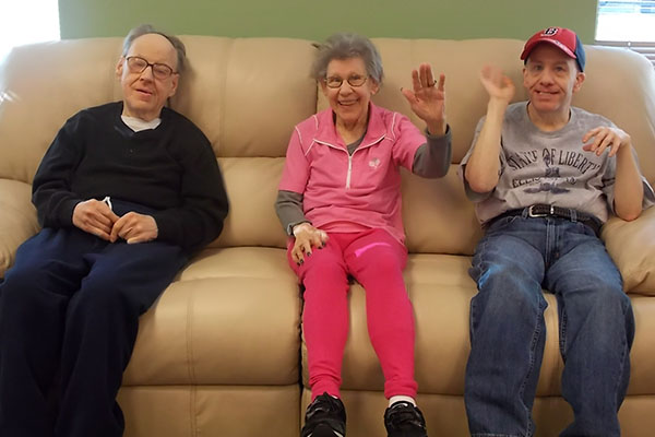 3 friends sitting on a couch