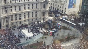 Photo by Tim Keough, taken from the 16th floor of 1515 Market Street: Massive crowds gathered at the end of the parade route at City Hall.