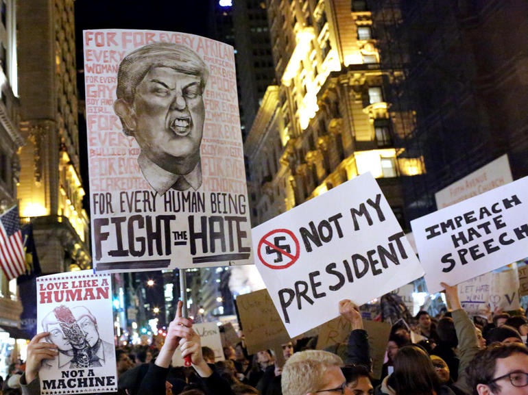 NEW YORK, NY - NOVEMBER 12: A crowd marches from Union Square to Trump Tower in protest of new Republican president-elect Donald Trump on November 12, 2016 in New York, United States. The election of Trump as president has sparked protests in cities across the country. (Photo by Yana Paskova/Getty Images)
