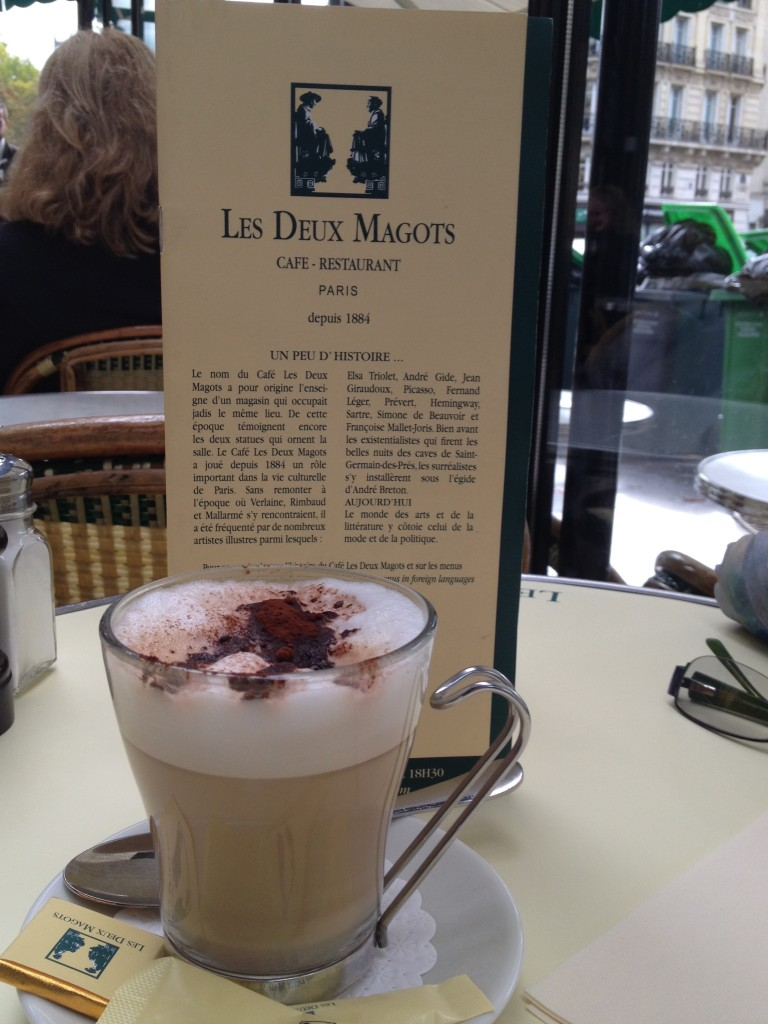 Sitting outside for breakfast at Les Deux Magots. they serve chocolate with everything!