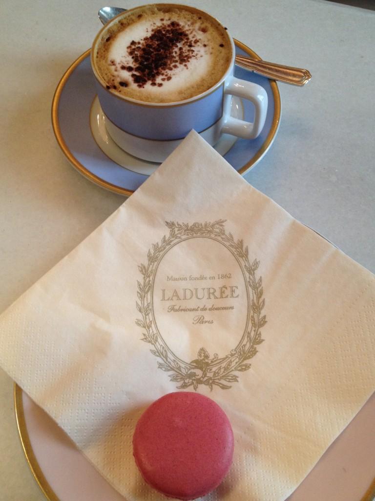 Enjoying a fresh macaroon and hot cappuccino from Laduree.