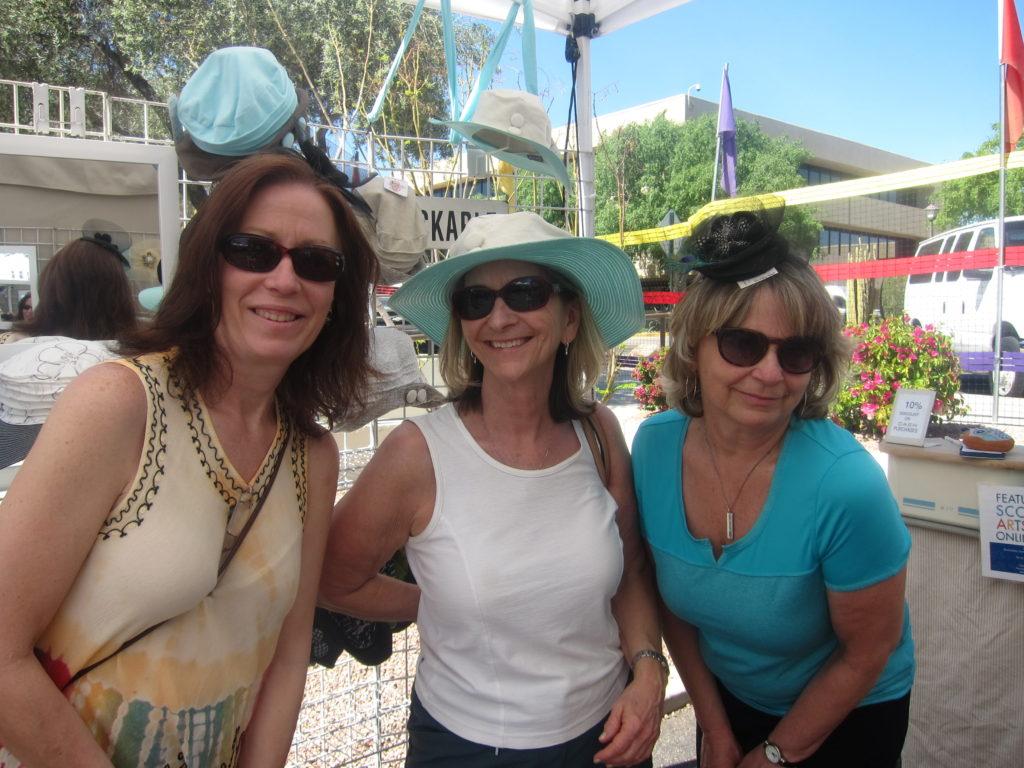 Fun hats, fun ladies, fun times at the Arts Festival