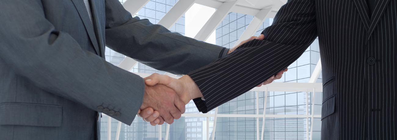 composite of business people shaking hands