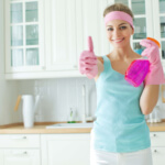 A woman cleans the house