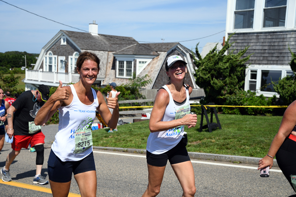 Housing Assistance CEO Alisa Magnotta and Chief Development Officer Anne Van Vleck running the Falmouth Road Race in August 2019.