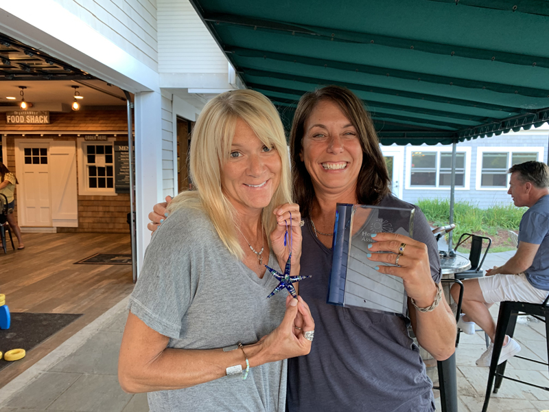 Meredith Fry and Robin Thayer were recognized for being the top two fundraisers for Housing Assistance's 2019 Falmouth Road Race team.