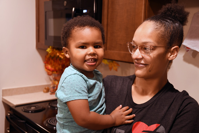 Housing Assistance client with her son.