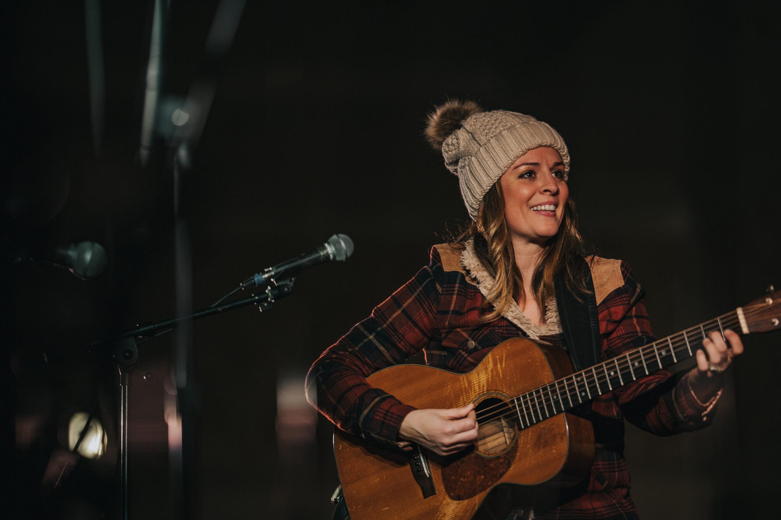 Musician Monica Rizzio performing at the 2018 Cape Cod Christmas Cavalcade