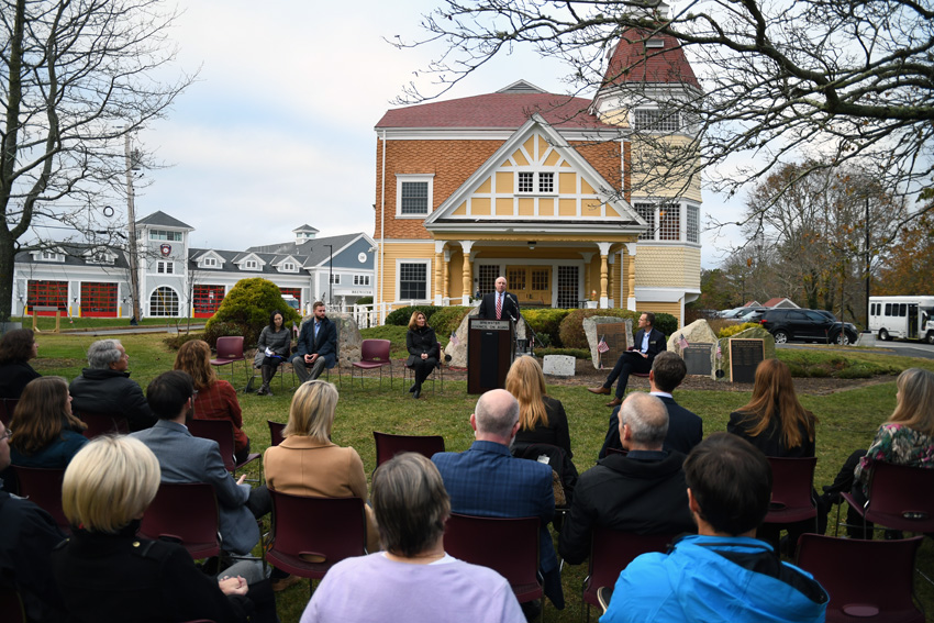 Massachusetts Department of Housing and Economic Development Secretary Mike Kennealy addresses the crowd during the MassWorks Grant announcement for Brewster Woods.