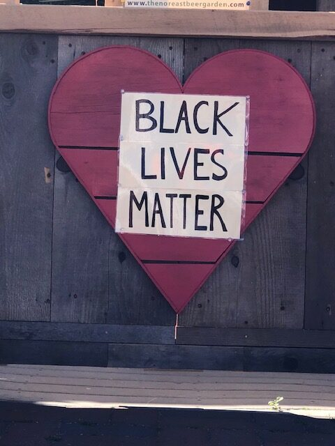 Black Lives Matter sign over a heart on Cape Cod