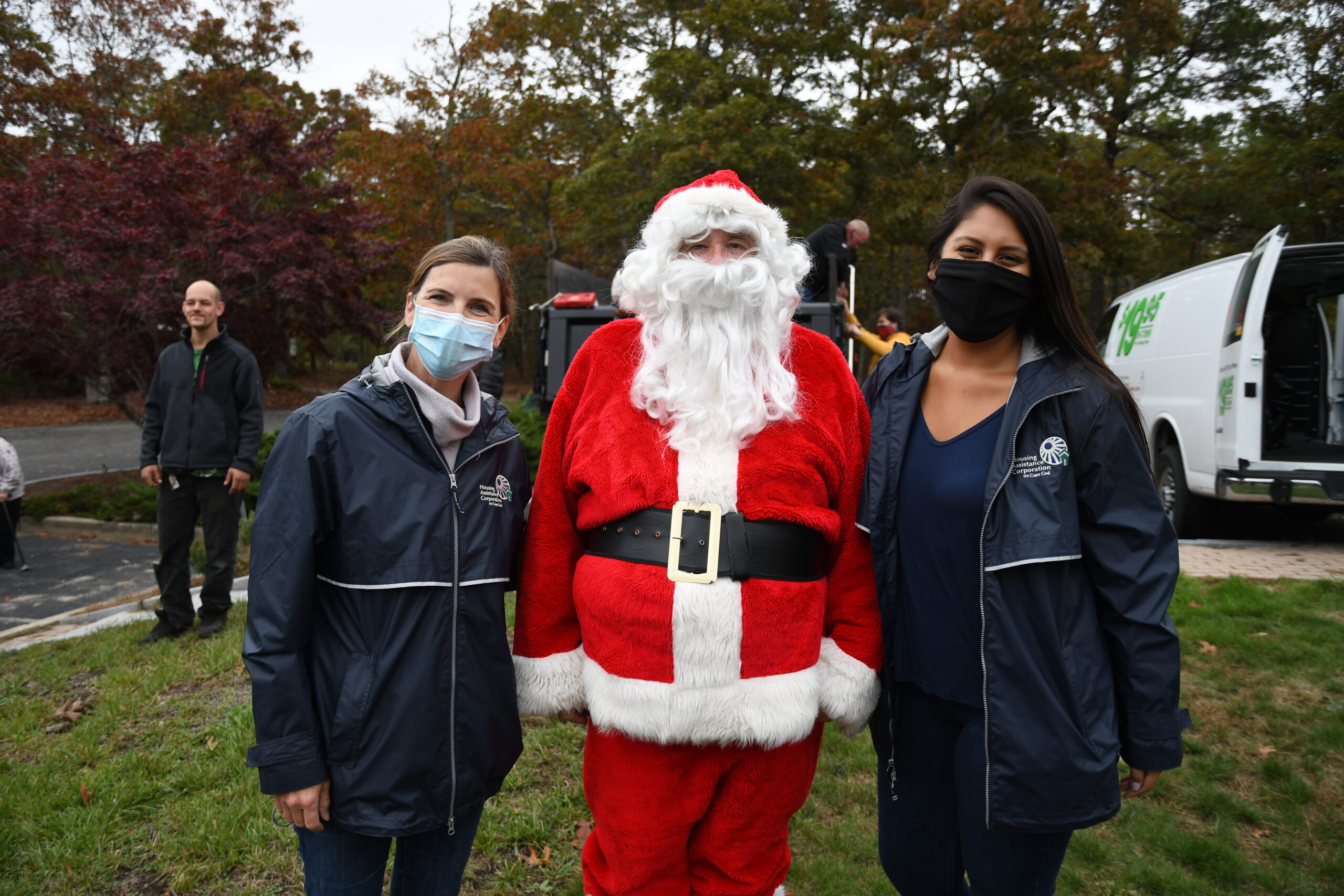 Santa Claus with Housing Assistance's Anne Van Vleck and Catherine Baker
