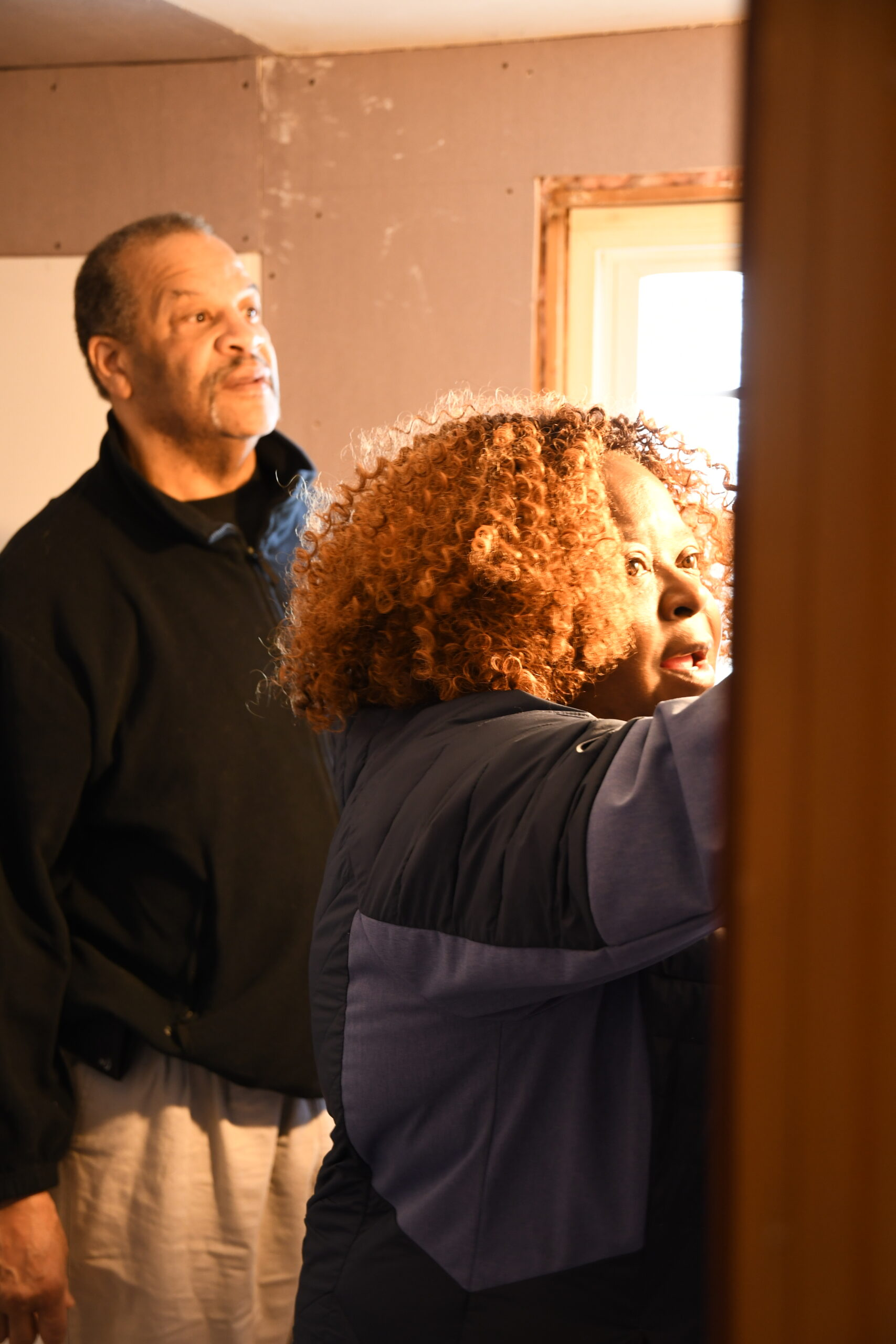 Douglas Mackie works with Delvashah McDaniel with health and safety upgrades in her bathroom.