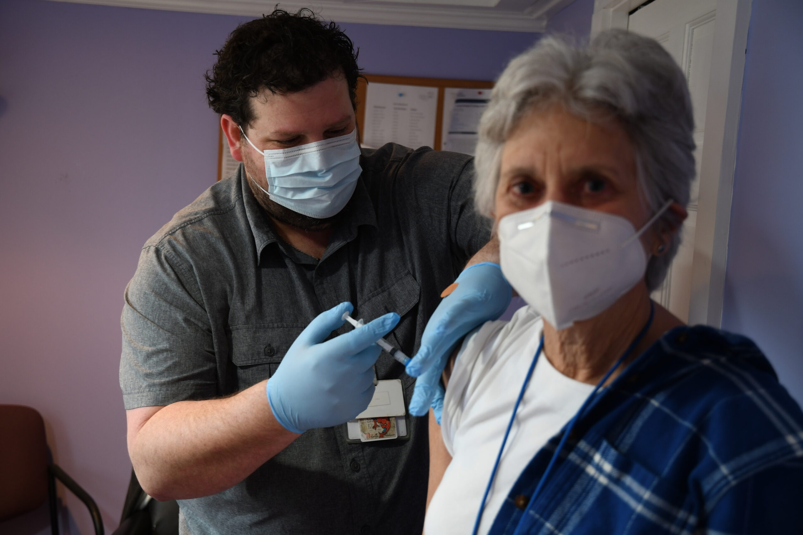 Angel House Shelter Director Lin Rohr receives her Covid-19 vaccination.