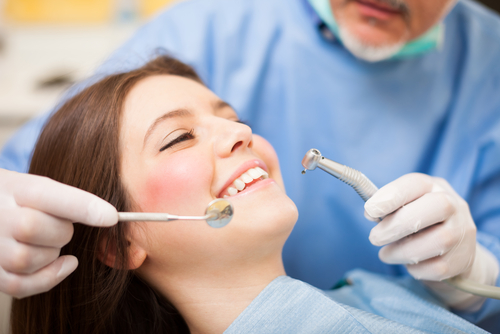 woman in a dentist chair getting a dental filling chalfont