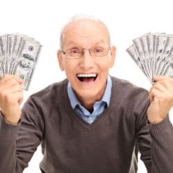 Picture of mature man holding cash