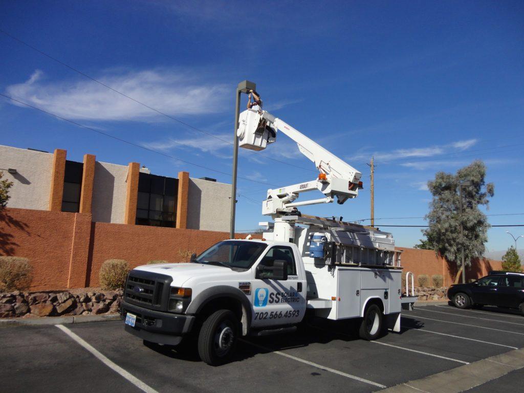 Bucket truck servicing parking lot light