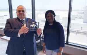 World Trade center miami chairman receives NASBITE award with Director, Africa Trade Program Kemi Arosayin