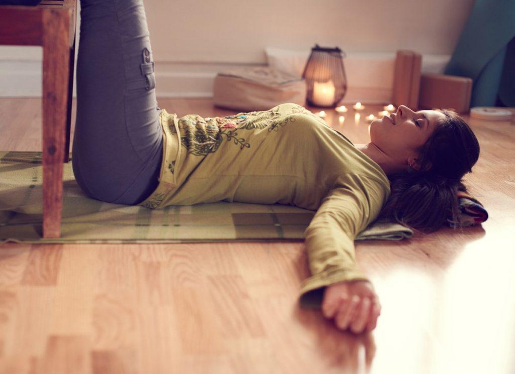 Woman in restorative yoga pose