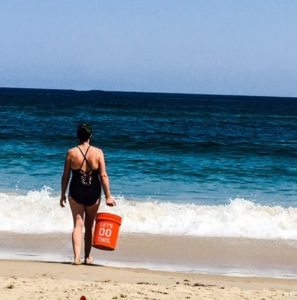 Beach buckets filled with sand or water help you get a great workout in!