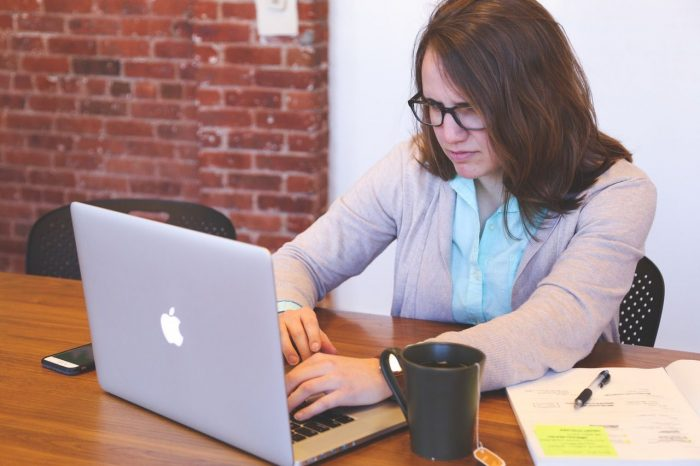 Woman stressed using laptop