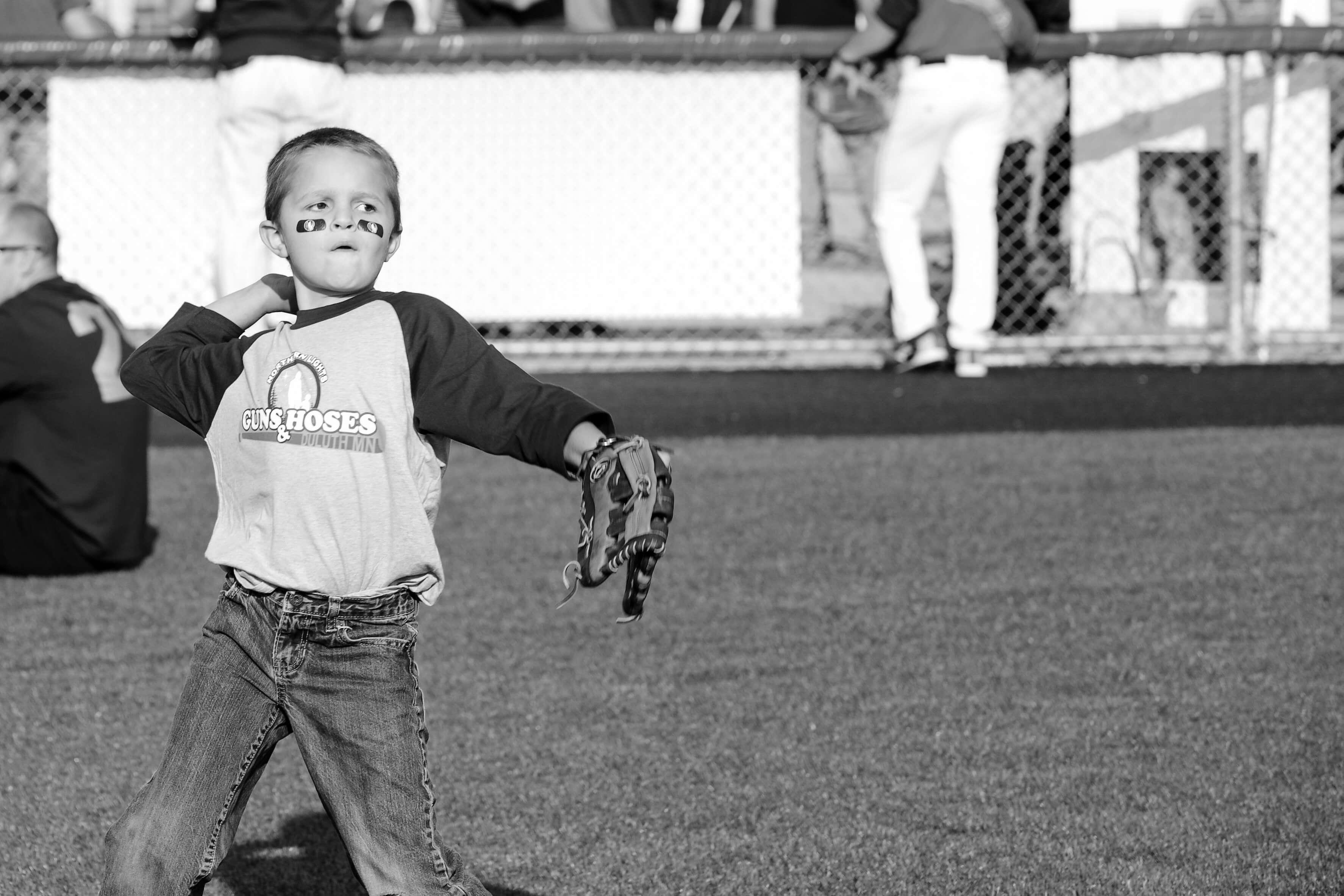 Northern Lights Foundation - Guns & Hoses kid throwing baseball