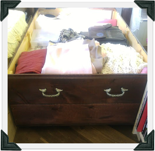 The humungous rolling drawer I built for under our bed