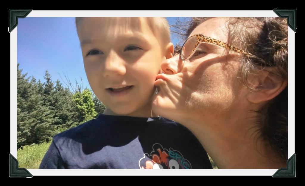 Kim kissing a grandchild on the cheek