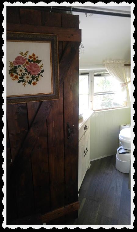 barn-style door to suit the dual purpose of closet and powder room door