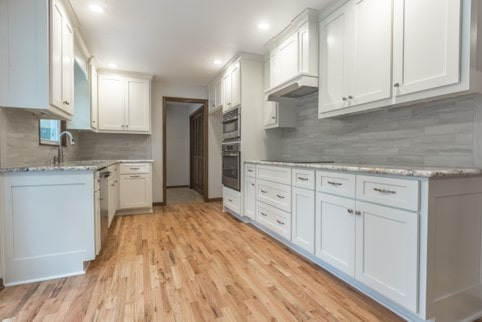 New shaker style white cabinets and recessed lighting in Davis kitchen remodel