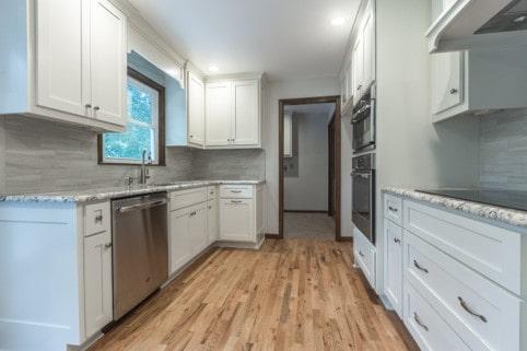 Davis kitchen white cabinets and stone natural mist tile backsplash