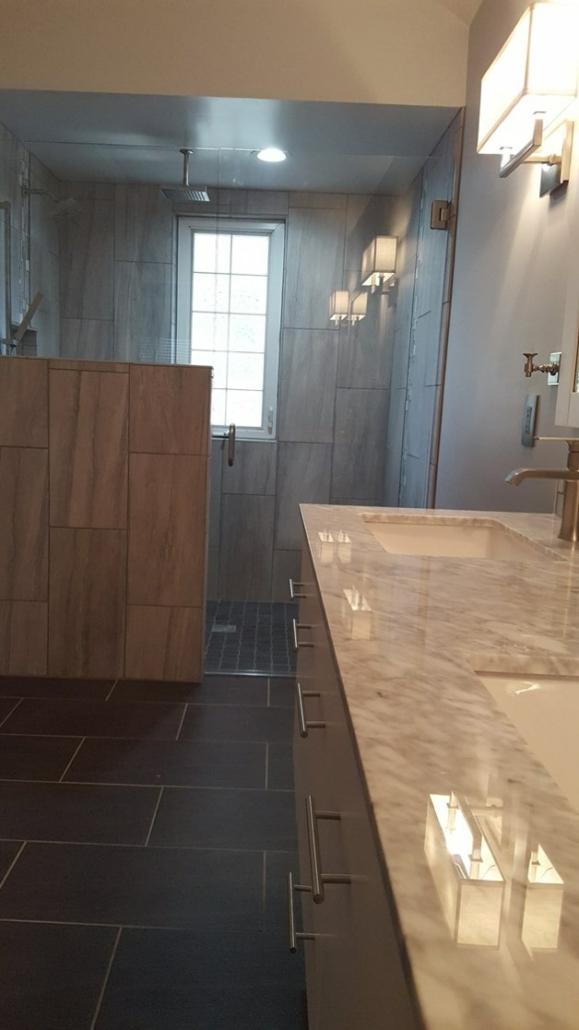 Grey bathroom with tile and half wall