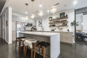 Keener kitchen with island and pendant lights