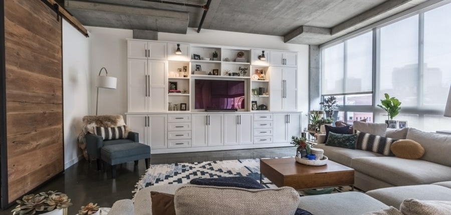 Keener living room with barn door and white entertainment center