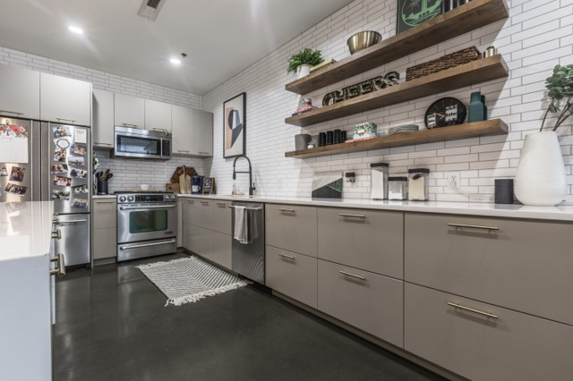 Kitchen condo style with white subway tile and floating shelving