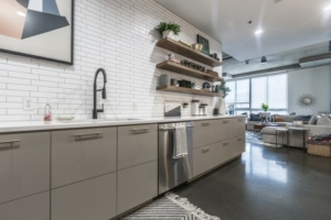 Kitchen condo style grey cabinets and floating shelving