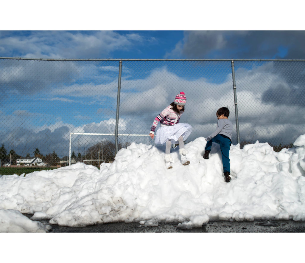 playing in the snow pile