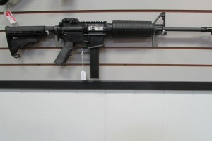 Colt AR6951 Does not share a magazine with a pistol but will share ammo.