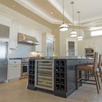 Phoenix Blackstone Custom Home Contemporary kitchen island with wine cooler and storage