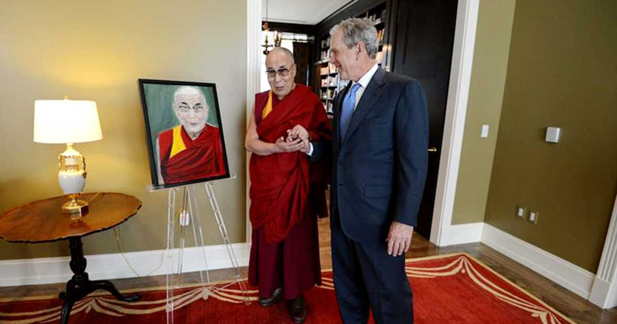 Dalai Lama stands next to President George W. Bush