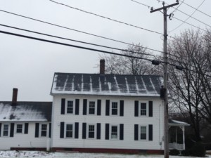 Yikes! Massive heat loss and snow melt. The rafters show the best insulation!