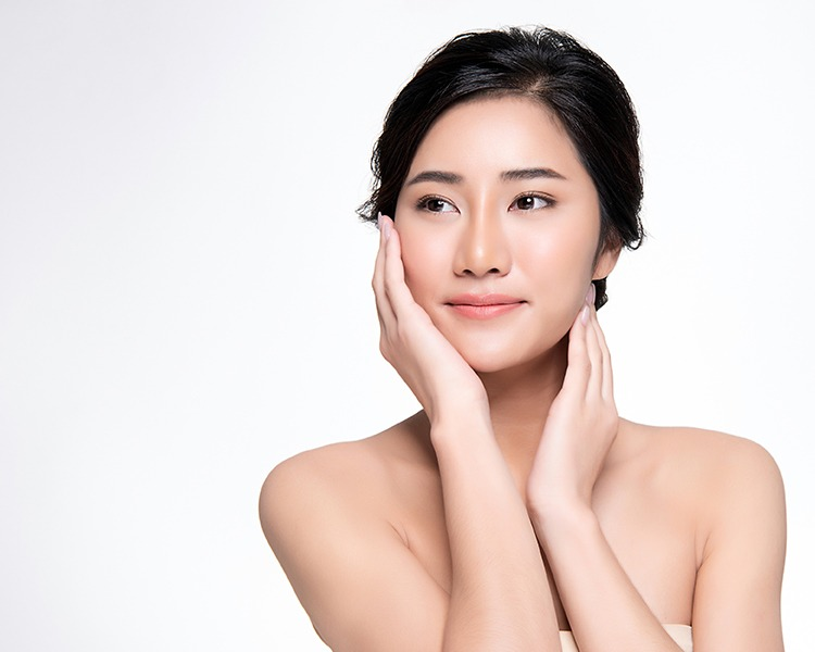 Woman feeling face with nice smooth skin