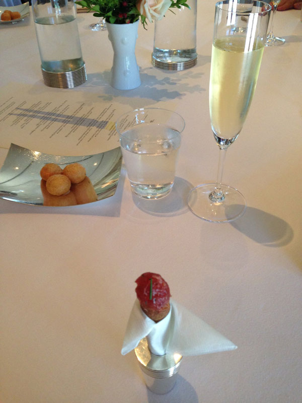 Ahi tuna tartare, puff pastry with cheese, champagne