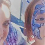 Image taken from a phone with a person with blue facepaint.