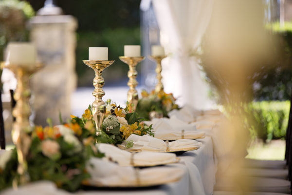 Candlesticks on a table set for dinner