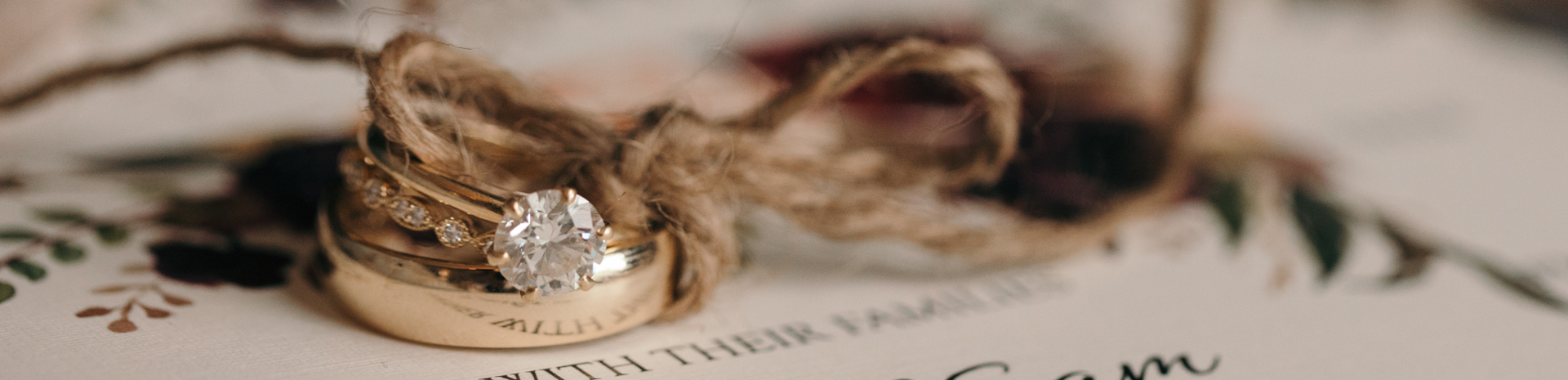 Two rings tied together with string lying on top of the order of service