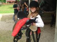 Tacking up with saddle