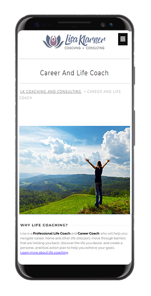 Photo of a phone with LK Coaching website on screen