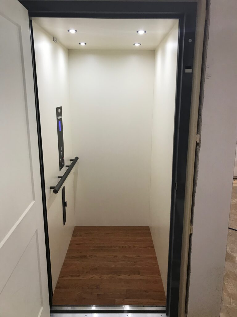 Traditional Home Elevator in White w Hardwood Floor